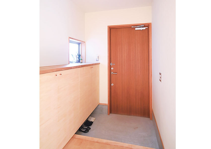防火設備認定のチーク材ドアの玄関